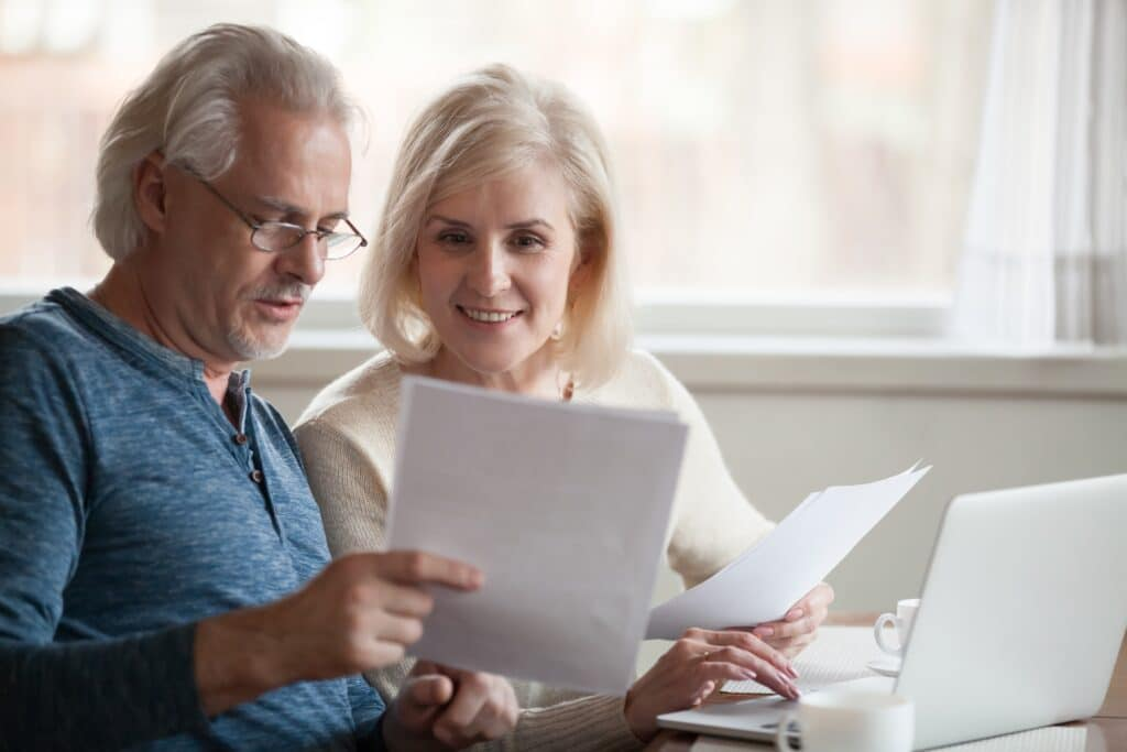 Older couple looks at investments on paper